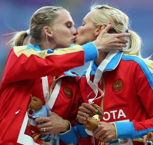 "Amidst the controversy over Russia's antigay laws, this photo of two Russian athletes kissing on the podium at the World Athletics Championships in Moscow was picked up by media outlets and sparked further debate. Was it a protest? Apparently not — both athletes issued denials, saying they were ""insulted"" by the idea that it was anything more than a victory peck. (Paul Gilham/Getty)"